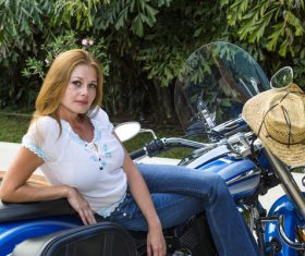 Woman sitting on motorcycle posing Stock Photo 12
