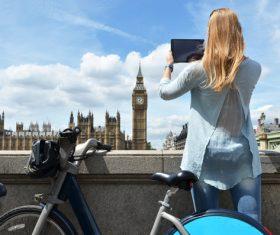 Woman using Tablet PC to take photos Stock Photo