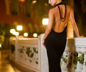 Woman wearing halter evening dress Stock Photo