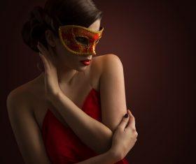 Woman wearing red mask Stock Photo