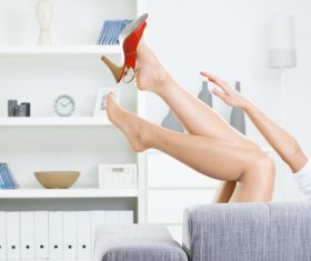 Womans feet and high heels Stock Photo