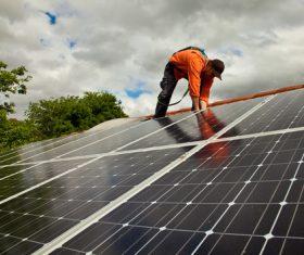 Workers Repair solar panels Stock Photo 01
