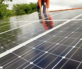 Workers Repair solar panels Stock Photo 02