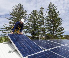 Workers Repair solar panels Stock Photo 03