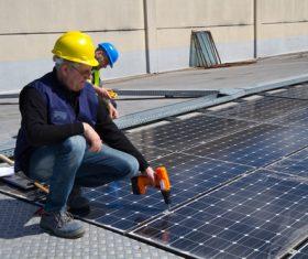 Workers Repair solar panels Stock Photo 04