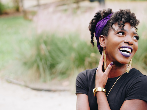 Young black woman posing with smiley Stock Photo