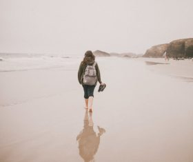 Young girl walking on seaside in casual style Stock Photo