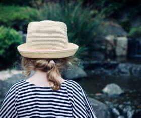 Young girl watching lake landscape Stock Photo