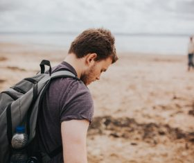 Young man by the sea Stock Photo