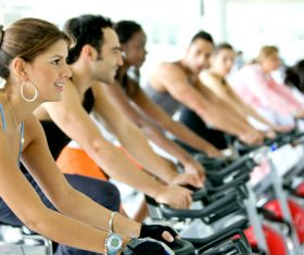 Young man doing aerobic exercise in gym Stock Photo