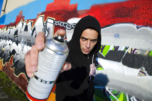 Young man holding a paint can Stock Photo