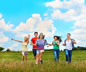 Young men and women running happily Stock Photo