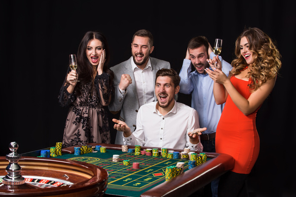 https://freedesignfile.com/upload/2018/06/Young-people-playing-roulette-Stock-Photo-08.jpg