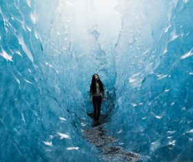 Young woman posing in frozen ice scene Stock Photo