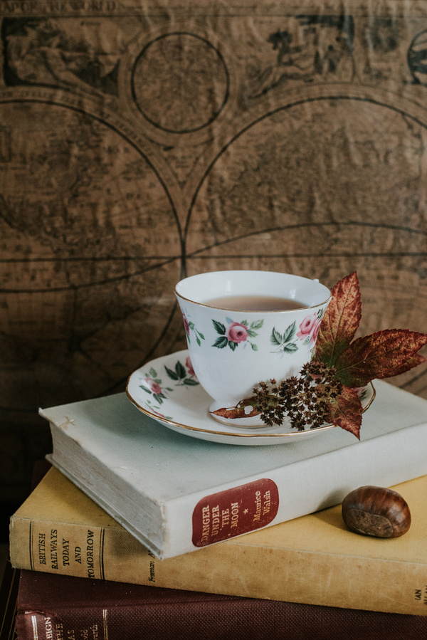 tea cup decoration on book Stock Photo