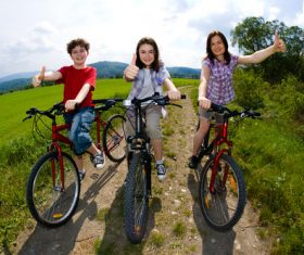 A family of three riding bicycle Stock Photo