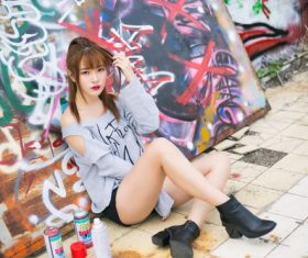 Asian girl in front of graffiti drawing board Stock Photo
