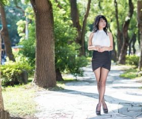 Asian girl posing in the park Stock Photo