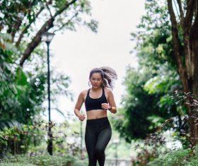 Asian girl running in the morning Stock Photo