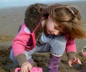 Beach little girl by the sea Stock Photo
