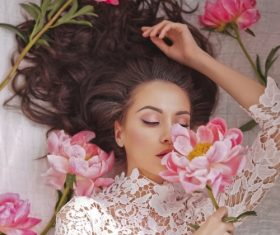 Beatutiful woman  lies among peonies Stock Photo (2)