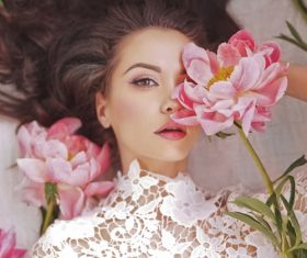 Beatutiful woman  lies among peonies Stock Photo (3)