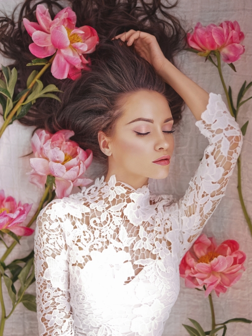 Beatutiful woman  lies among peonies Stock Photo (4)
