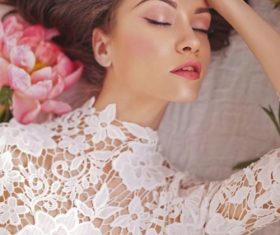 Beatutiful woman  lies among peonies Stock Photo (6)