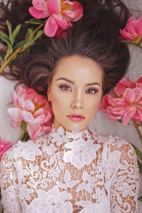 Beatutiful woman  lies among peonies Stock Photo (7)