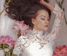 Beatutiful woman  lies among peonies Stock Photo (9)
