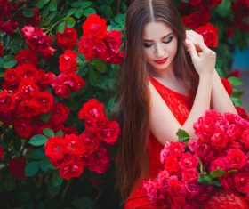 Beautiful girl in the blossoming garden Stock Photo 01