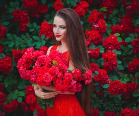 Beautiful girl in the blossoming garden Stock Photo 02