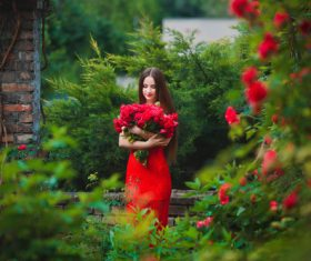 Beautiful girl in the blossoming garden Stock Photo 03