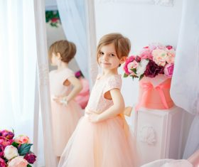 Beautiful little girl dressed in front of the mirror Stock Photo 01