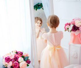 Beautiful little girl dressed in front of the mirror Stock Photo 02
