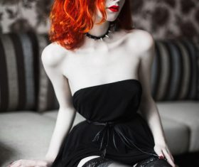 Beautiful redheaded girl wearing black tube top dress Stock Photo