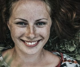 Beautiful woman with lots of freckles on face Stock Photo