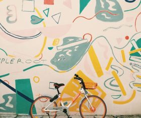 Bicycle near artistic painted wall Stock Photo
