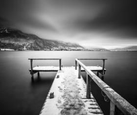 Black white picture of jetty on calm lake Stock Photo