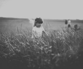 Black white picture of small girl playful outdoor Stock Photo