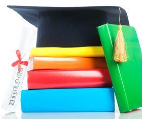 Book diploma and graduation cap Stock Photo