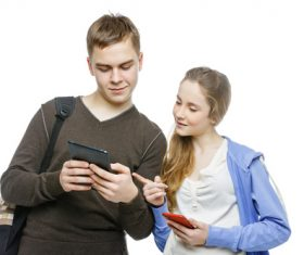 Boy and girl exchanging mobile numbers Stock Photo