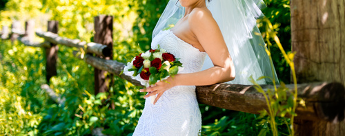 Bride in white wedding dress standing Stock Photo 01