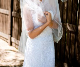 Bride in white wedding dress standing Stock Photo 02