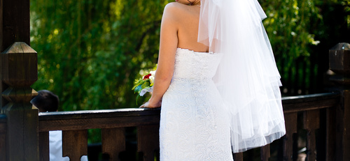 Bride standing on bridge and taking wedding photographs Stock Photo 01
