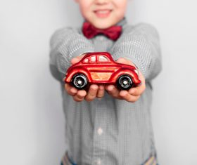Child holding toy car in hand Stock Photo