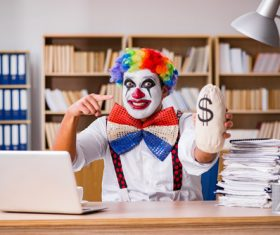 Clown in the office Stock Photo 01