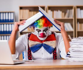Clown in the office Stock Photo 02