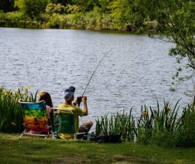 Couple fishing by the river Stock Photo