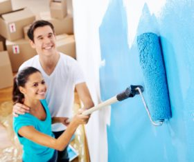 Couple new home paint Stock Photo